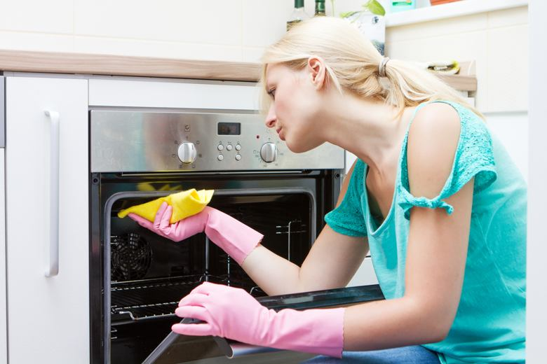 students-cleaning-oven