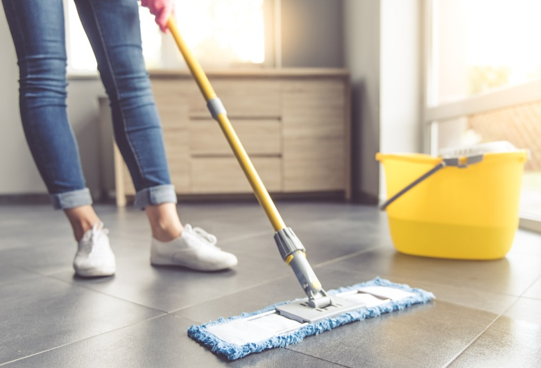 Cleaning floor to prevent the spread of germs.