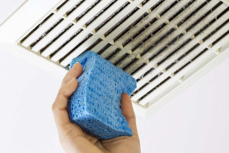 Cleaning dust from air vents.